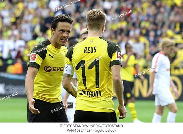 Dortmund, Germany 26. August 2018: 1. BL - 18/19 - Borussia Dortmund vs. RB Leipzig v.li. Thomas Delaney (Dortmund) and Marco Reus (Dortmund) Mimic / strong...