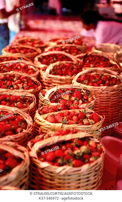 Baskets of strawberries. Open air market. San Miguel de Allende. Mexico