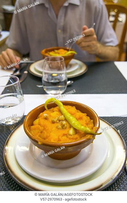 Patatas revolconas serving in a restaurant. Salamanca province, Spain