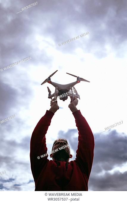 A man with a drone in his arms