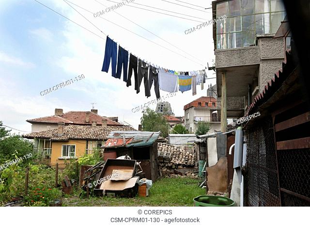 Laundry hanging fom an old house in the backyard of a residential area in Bulgaria