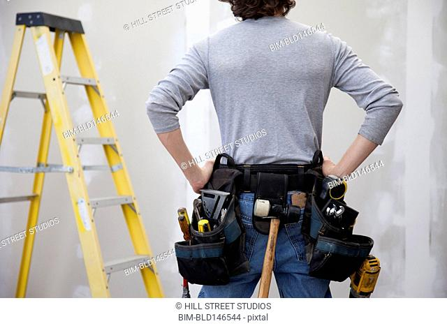 Caucasian man wearing tool belt