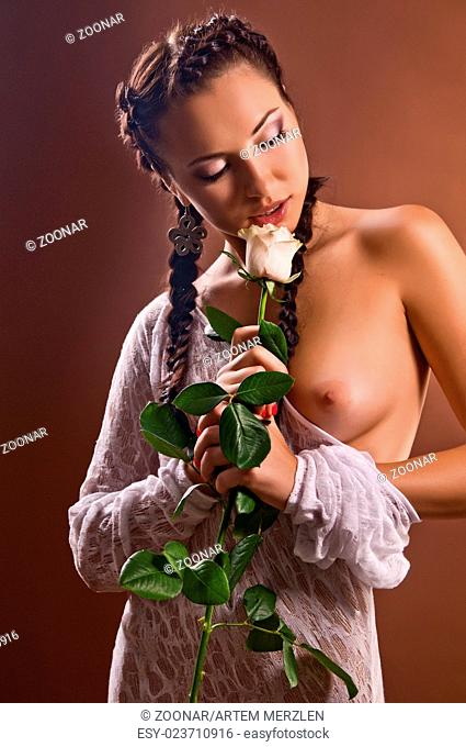 beautiful naked woman with a rose