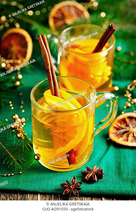 Hot apple cider in a glass cup