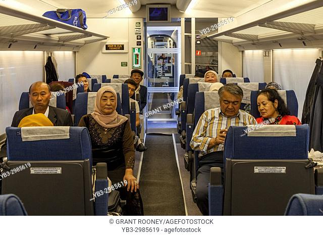 Uzbek Passengers Sitting On The Afrosiyob High Speed Train, The Railway Station, Bukhara, Uzbekistan