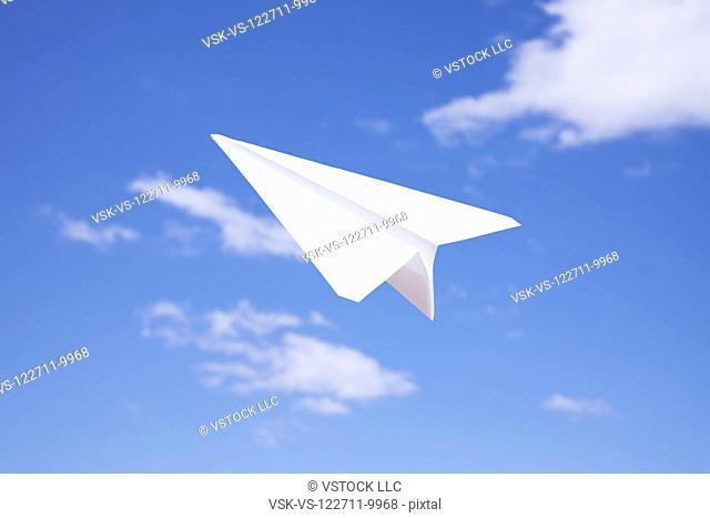 USA, Illinois, Metamora, Paper plane in flight