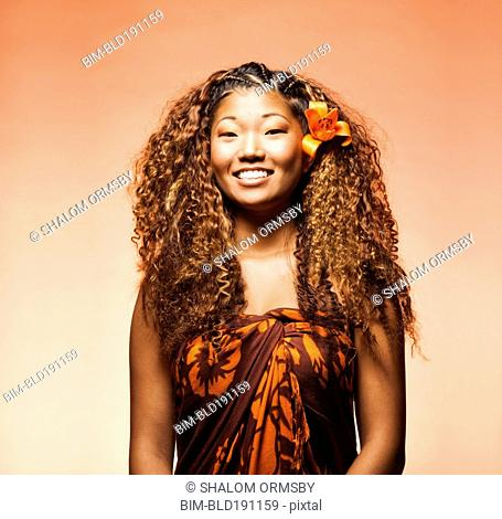 Japanese woman with exotic flower in her hair