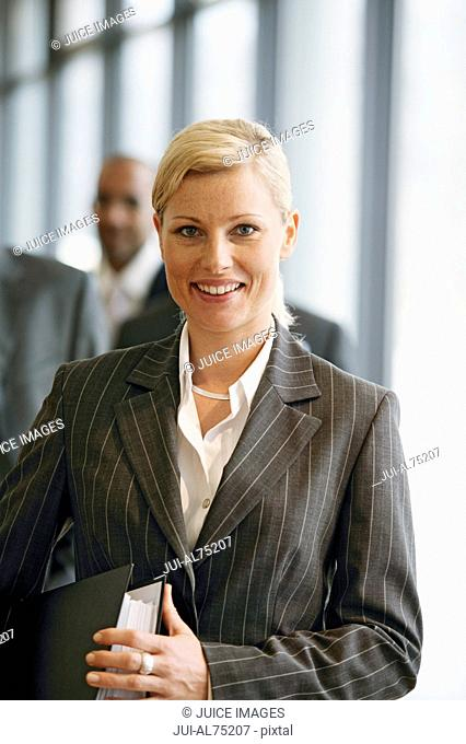 View of a businesswoman with businessmen out of focus