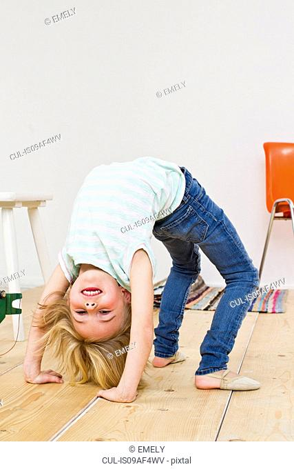 Studio shot of girl bending backwards doing the crab