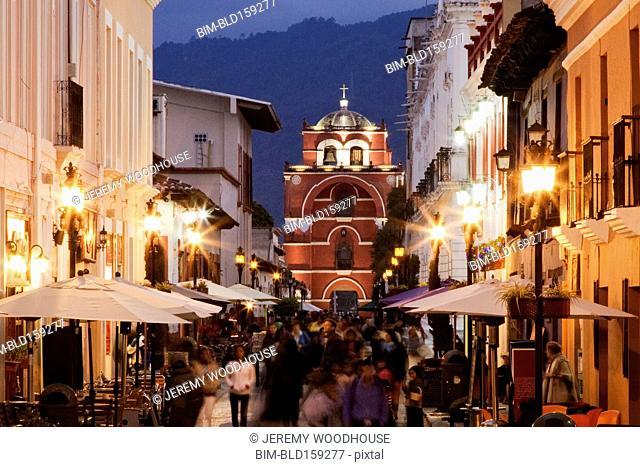 Blurred motion view of tourists walking on San Cristobal de las Casas street, Chiapas, Mexico