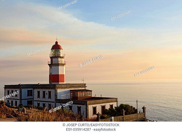 Sunset at lighthouse of Cape Sillerio, Pontevedra province, Galia, Spain