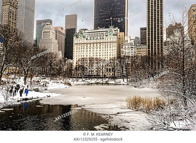 The Pond Partially Frozen After A Snowstorm, In Central Park; New York City, New York, United States Of America