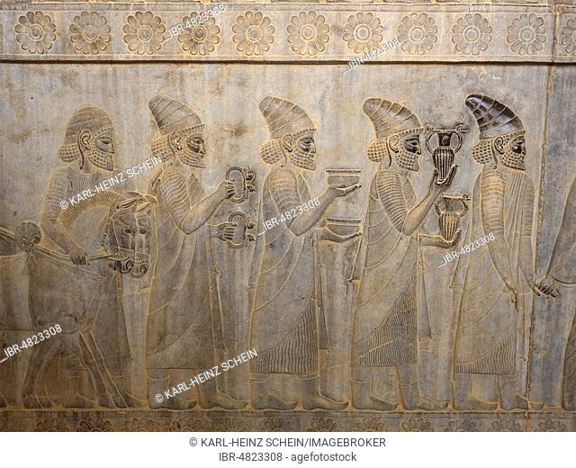Ancient relief of the Achaemenids, delegation brings gifts, Apadana Palace, archaeological excavation site, ancient Persian royal seat Persepolis, Fars Province