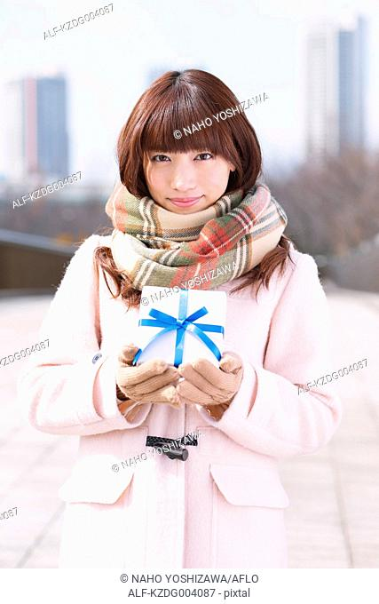 Attractive Japanese woman with gift on a Winter day
