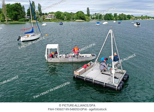 06 June 2019, Switzerland, Uttwil: Archaeologists and geologists are preparing a platform for drilling on Lake Constance