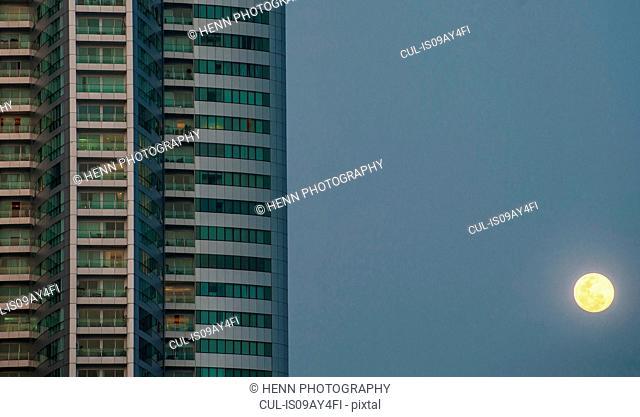 Skyscraper and the moon, Benjakiti Park, Bangkok, Thailand