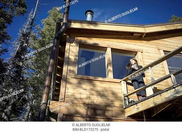 Caucasian woman standing on cabin deck