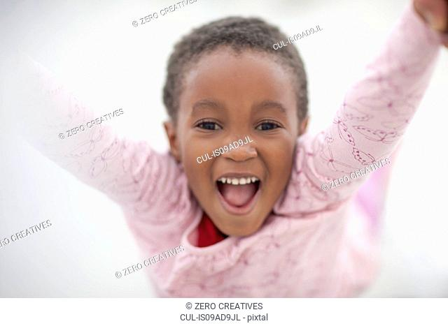 Girl raising arms in excitement