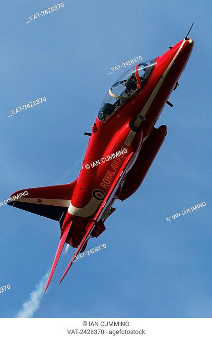 Red Arrow jet performing flypast at Duxford Air Show; Cambridgeshire, England