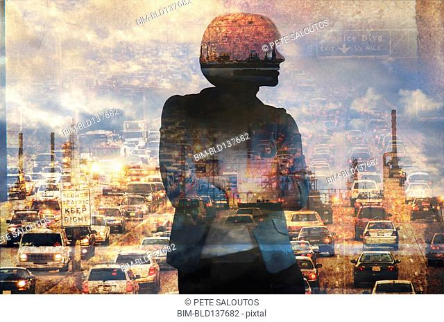 Double exposure of businesswoman and traffic