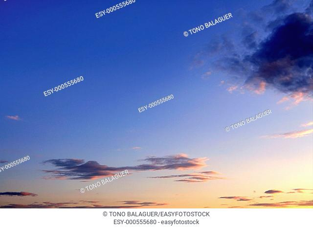 Blue sky background with clouds at sunset