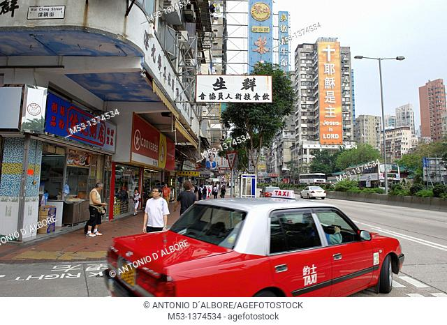 Taxi leave Wai Ching Street and entering Jordan Road, a popular commercial road in Jordan district A huge billboard on a building says 'Jesus is Lord' in...