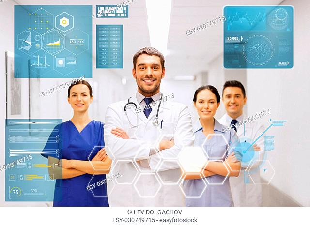 people, healthcare and medicine concept - happy group of medics or doctors at hospital corridor
