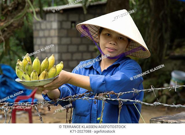 Selling bananas at the Ming Mang Tomb near Hue, Vietnam, Asia