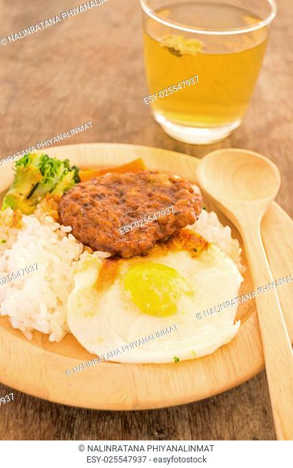Rice with hamburg steak and fried egg, stock photo