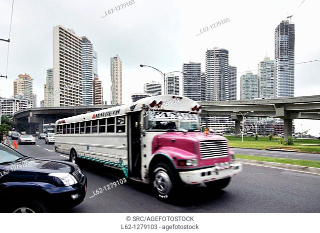 'Diablo rojo' customised bus, Cinta Costera, Panama City, Panama