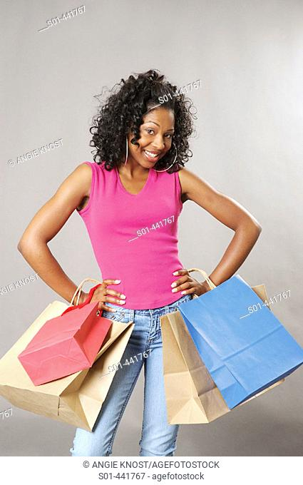 Young black woman with four shopping bags