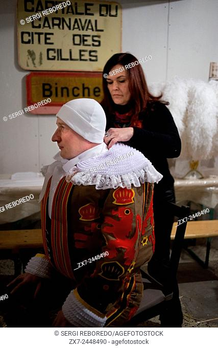 Dressing at home for the Binche Carnival. Preparation, preparations, put the dress. The carnival of Binche is an event that takes place each year in the Belgian...