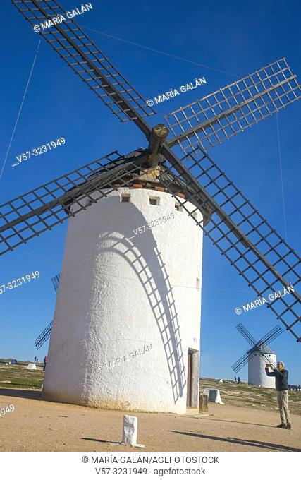Windmill and tourist taking photos. Campo de Criptana, Ciudad Real province, Castilla La Mancha, Spain