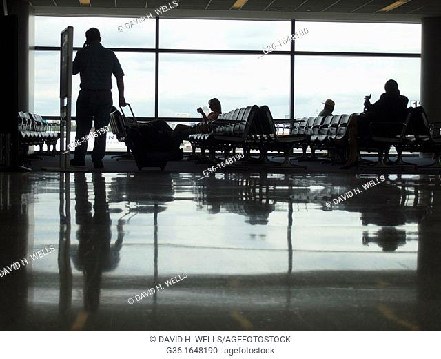Silhouettes of travelers in an airport terminal in Newark, New Jersey, United States