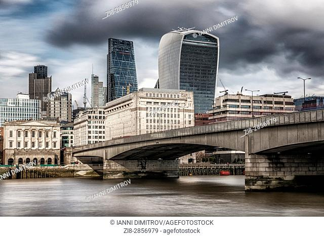 England, London, London Bridge-storm clouds over the City of London