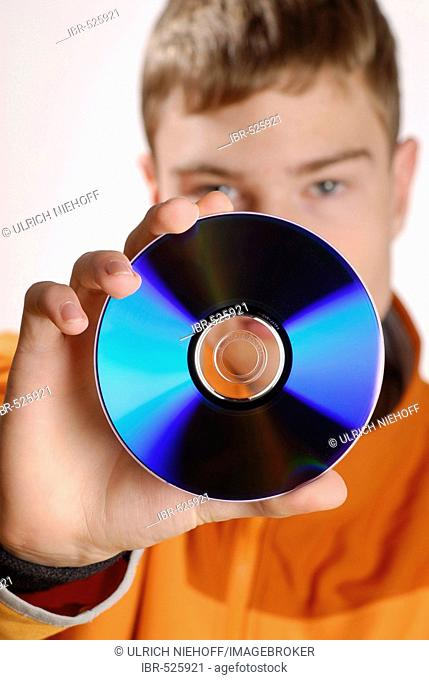 Teenager holding a CD
