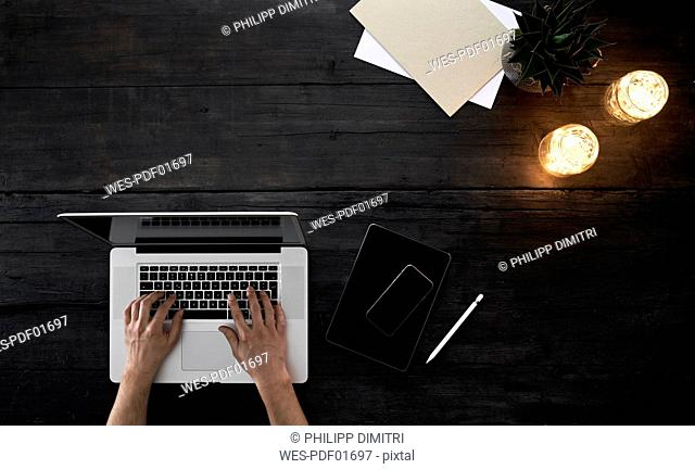 Person working in office, using laptop
