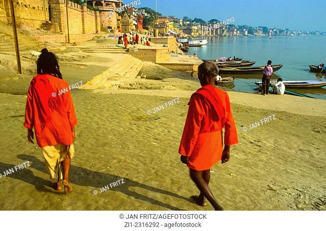 two sadhus in red sari's at the ghats of varanasi, india