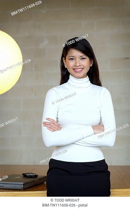 Portrait of Asian businesswoman with arms crossed