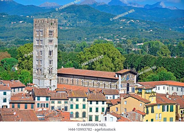 Aerial view of the basilica of St Frediano (an Irish bishop) with it's byzantine style mosaic, in Lucca, Italy. In the background the apennine mountains