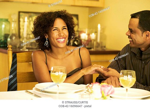 Smiling Couple at Dinner