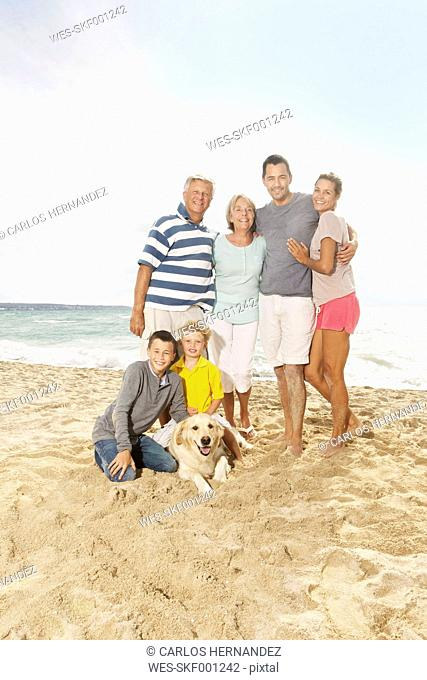 Spain, Portrait of family on beach at Palma de Mallorca, smiling