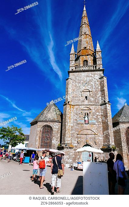 Market full of tourists in front of church. Carnac, Brittany, France