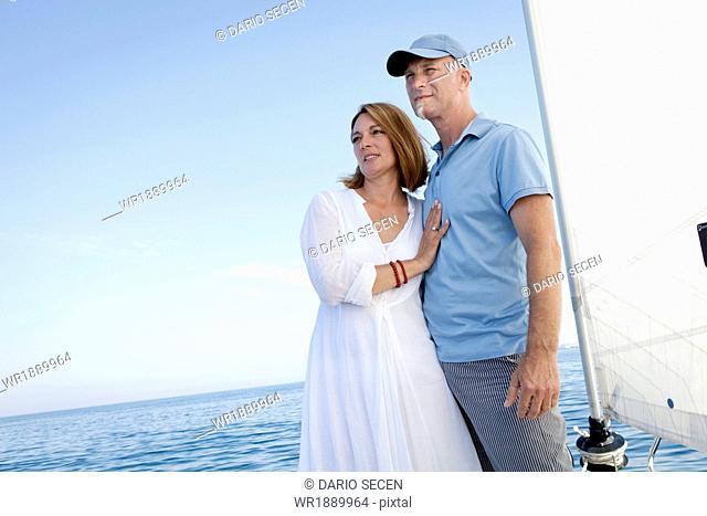 Mature couple on sailboat, looking away, Adriatic Sea, Croatia