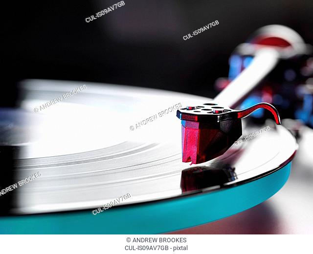 Close up of a vinyl record and stylus on turntable