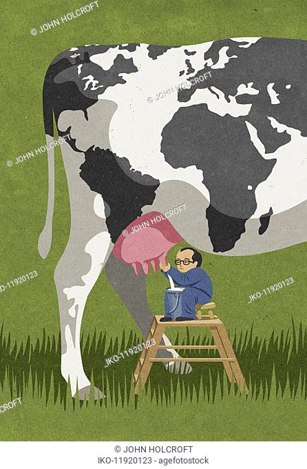 Businessman milking cow with world map pattern