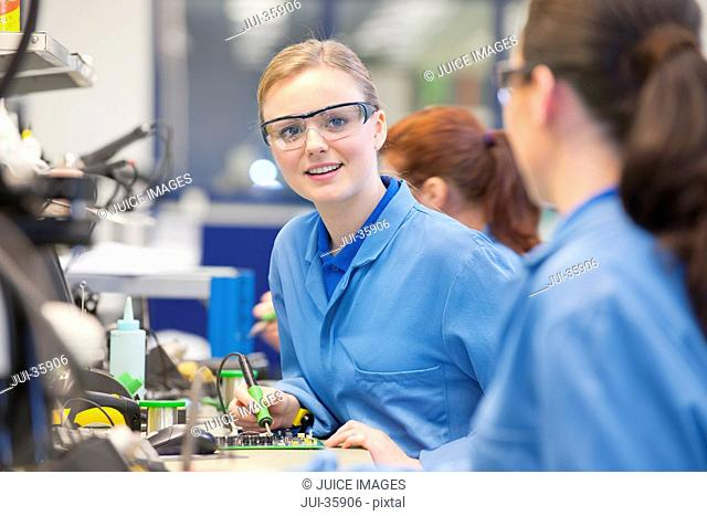 circuit board production line manufacturing plant stock photos and