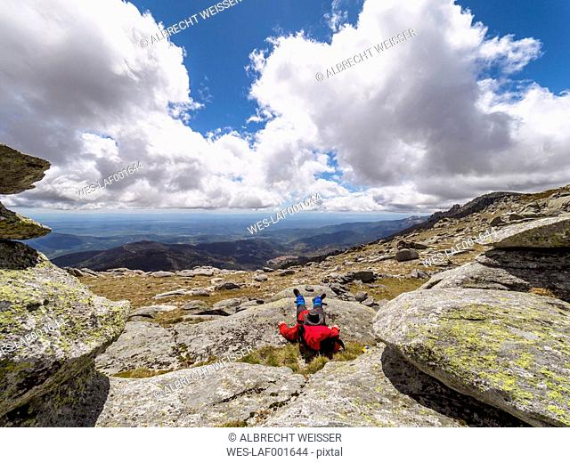 Spain, Sierra de Gredos, hiker sitting in mountainscape