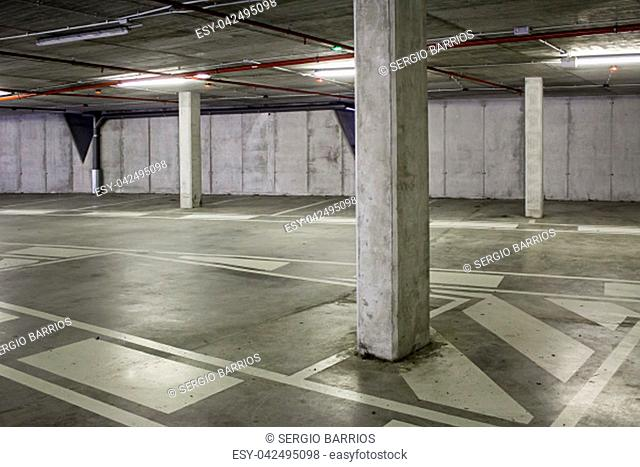 Interior of an empty car park, detail of a place to leave cars, interior architecture