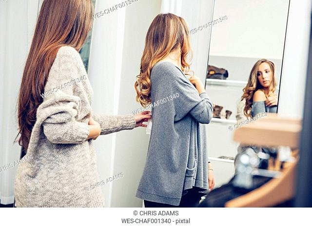 Two young women shopping in a boutique